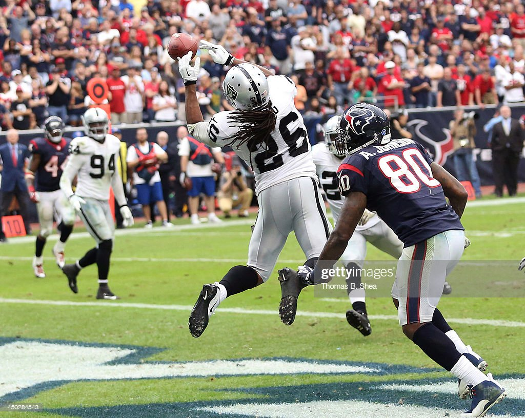 Usama Young #26 of the Oakland Raiders breaks up a pass intended for Andre Johnson #80 of the Houston Texans on November 17, 2013 at Reliant Stadium in Houston, Texas. Raiders won 28 to 23.