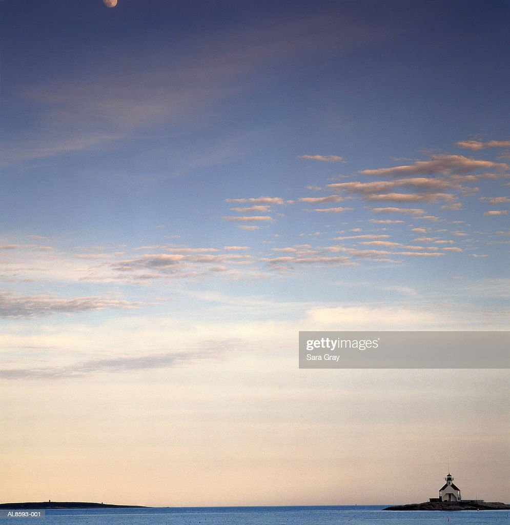 USA,Maine,lighthouse on calm water at dusk with moonrise : Stock Photo