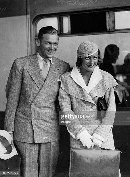 USamerican actress Joan Crawford and her husband Douglas Fairbanks jr at their arrival in London/Waterloo Station July 15th 1932 Photograph Die...