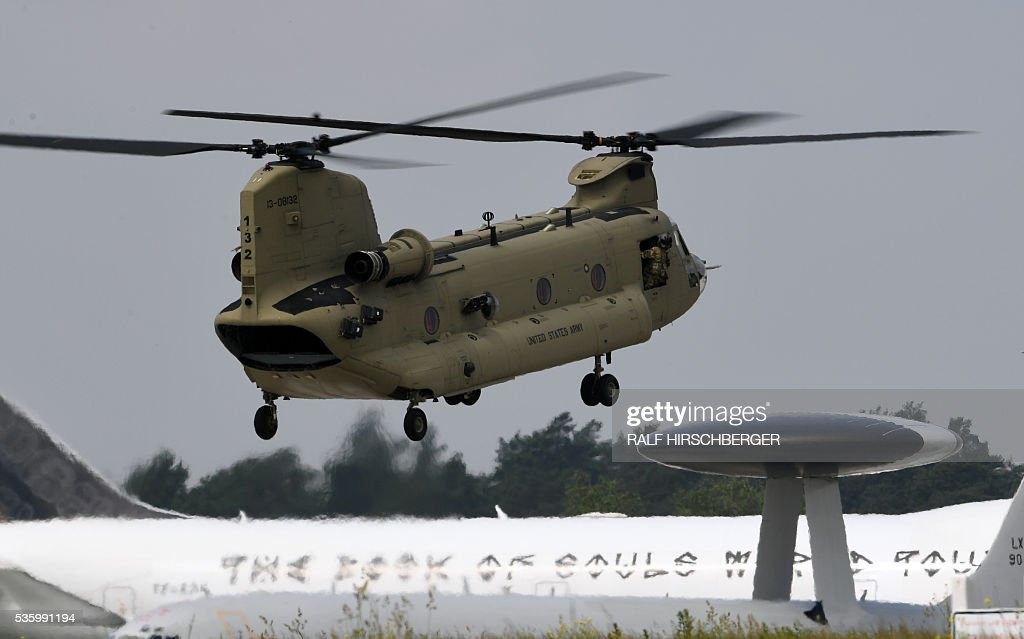 US-Army twin-engine, tandem rotor heavy-lift helicopter 'Chinook' lands at the International Aerospace Exhibition (ILA) in Schoenefeld on May 31, 2016. The Aerospace Exhibition at Schoenefeld Airport near Berlin takes place from June 1 till 4. / AFP / dpa / Ralf Hirschberger / Germany OUT