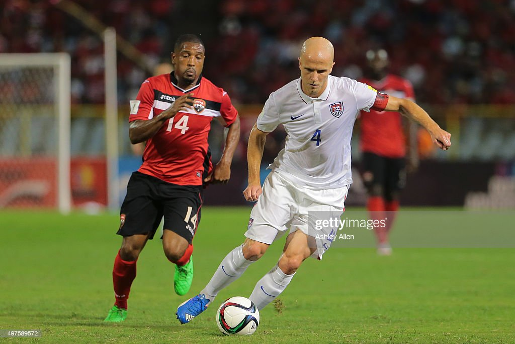 Usa's captain Michael Bradley makes an attacking run as TT's Andre Boucaud chases during a World Cup Qualifier between Trinidad and Tobago and USA as...