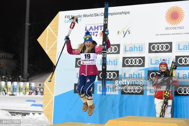 USAs Jessica Diggins celebrates on the Podium next to Norways Maiken Caspersen Falla after the women's crosscountry 14 km sprint final at the FIS...