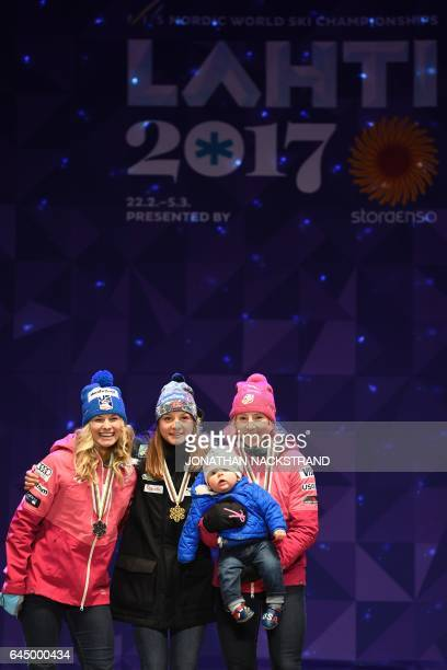 USAs Jessica Diggins Norways Maiken Caspersen Falla and USAs Kikkan Randall celebrate during the medals ceremony for the women's crosscountry 14 km...