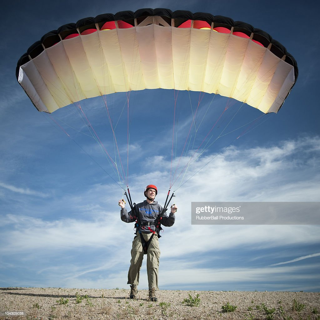 USA,Utah,Lehi,Young male parachutist standing on desert,front view : Stock Photo