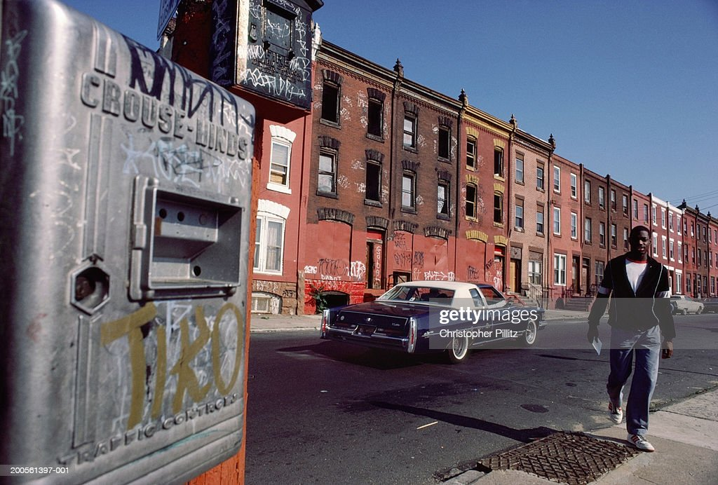 USA,Washington DC,youth walking in derelict and violent neighbourhood : Stock Photo