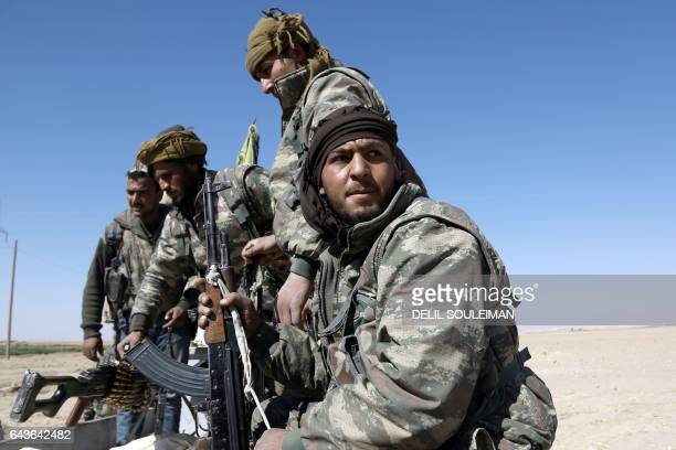 TOPSHOT USbacked Syrian Democratic Forces made up of an alliance of Arab and Kurdish fighters advance in the village of Sabah alKhayr on the northern...