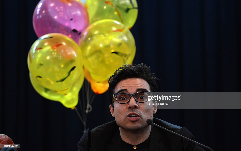 US-based artist Yazmany Arboleda from 'We Believe In Balloons' addresses a press conference in Kabul on February 18, 2013. Despite grinding poverty and more than three decades of war, a New York-based artist believes 10,000 pink balloons can help bring peace and happiness to Afghans on the streets of Kabul. Yazmany Arboleda has already unleashed coloured balloons in India, Japan and Kenya. He hopes that Afghanistan can be the next to benefit from 'simple happiness' despite being in the grip of an 11-year Taliban insurgency.