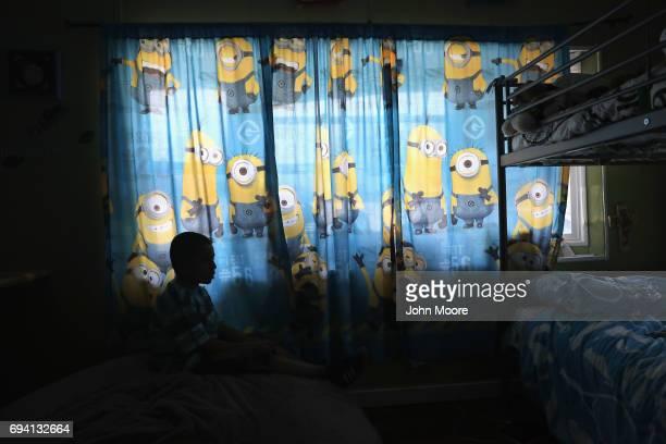 Sborn Byran son of undocumented Peruvian immigrant Ingrid Encalada sits in his room on June 6 2017 in Thornton Colorado Encalada was given a...