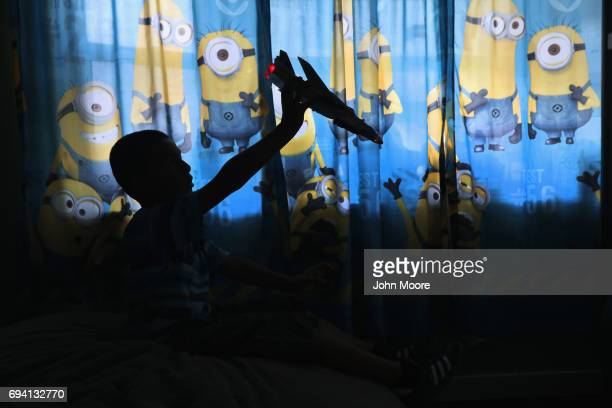 Sborn Byran son of undocumented Peruvian immigrant Ingrid Encalada plays in his room on June 6 2017 in Thornton Colorado Encalada was given a...