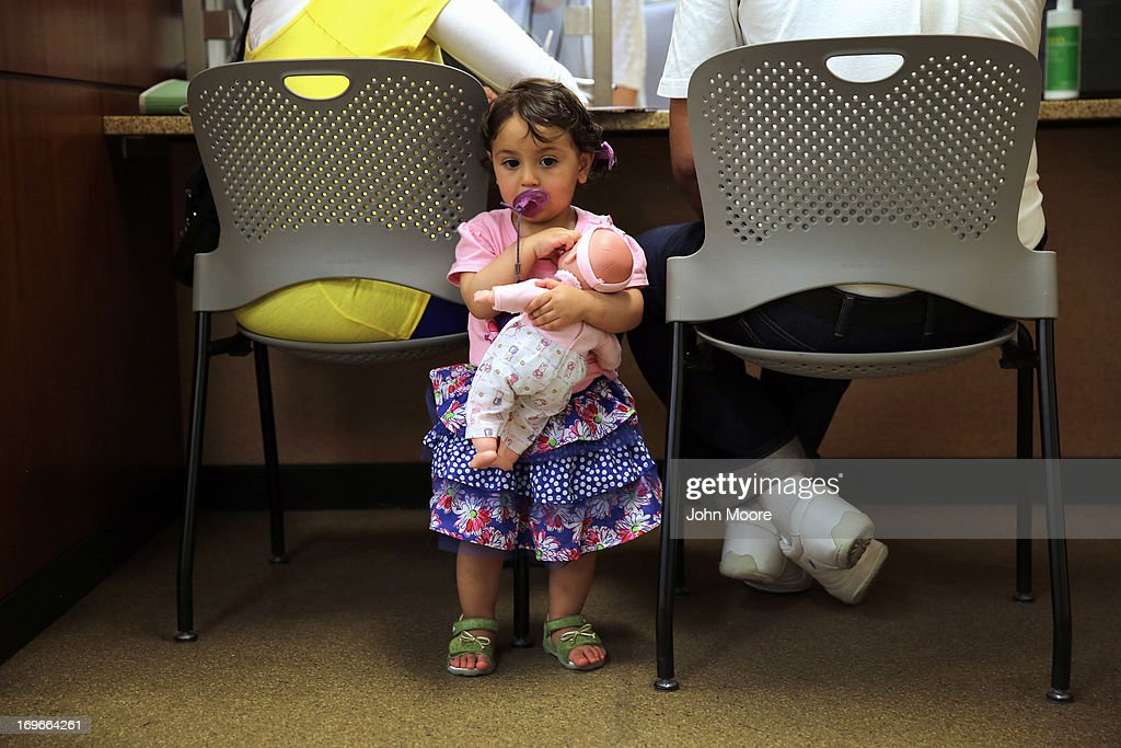 U.S.-born Rinava Arif, 15 months, waits during her Egyptian parents' citizenship interview at the U.S. Citizenship and Immigration Services (USCIS) Queens office on May 30, 2013 in the Long Island City neighborhood of the Queens borough of New York City. The branch office is located in an area heavily populated by immigrants and processes thousands of green card and U.S. citizenship applications each year.