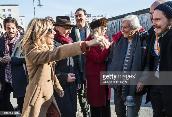 USBritish actress Sienna Miller greets German actor Daniel Bruehl as they and other jury members and delegates at the 67th Berlinale film festival...
