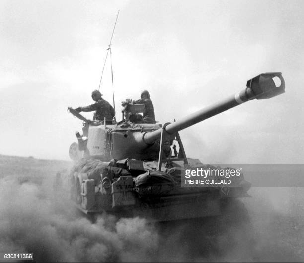 A USbuilt Israeli tank churns dust in the desert in this photo taken in June 1967 on the Golan Heights Thirty years after the sixday war new...