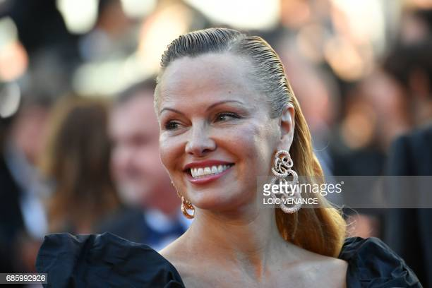 USCanadian actress Pamela Anderson poses as she arrives on May 20 2017 for the screening of the film '120 Beats Per Minute ' at the 70th edition of...