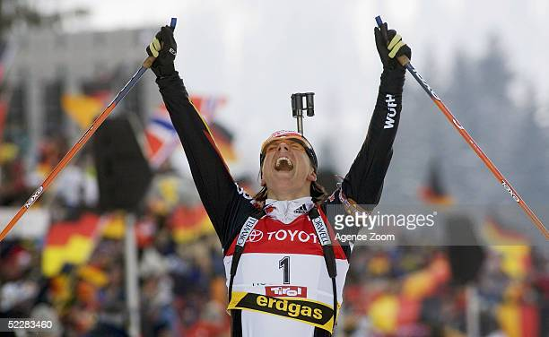Uschi Disl of Germany celebrates after the Women's 10km Pursuit in the Biathlon World Cup event March 6 2005 in Hochfilzen Austria
