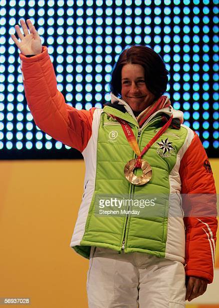 Uschi Disl of Germany receives the Bronze medal in the Womens Biathlon 125km Mass Start at the Medals Plaza on Day 15 of the 2006 Turin Winter...