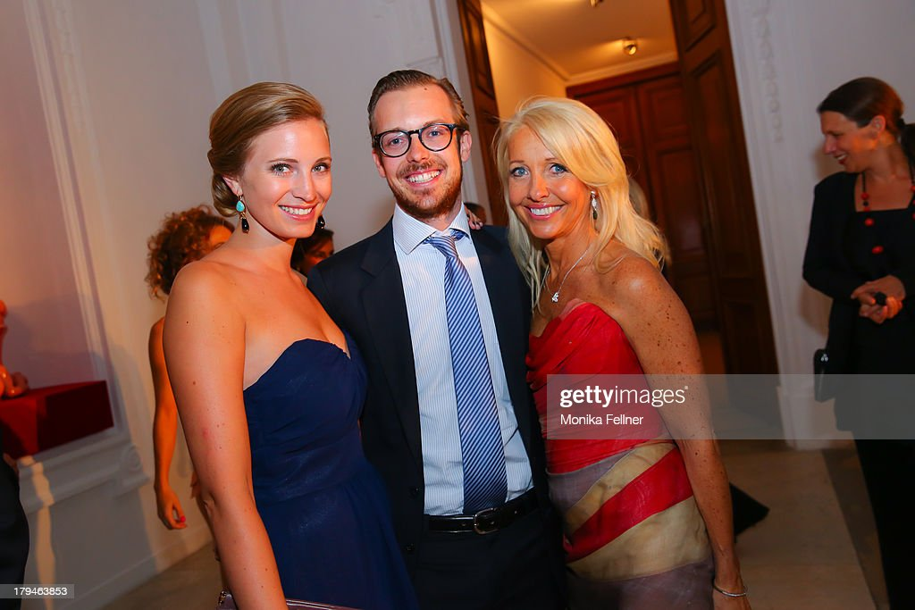 Uschi Fellner (1R) with Niki Fellner (M) and his company attend the Leading Ladies Awards 2013 at Belvedere Palace on September 3, 2013 in Vienna, Austria.