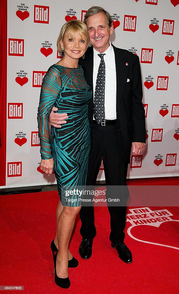 <a gi-track='captionPersonalityLinkClicked' href=/galleries/search?phrase=Uschi+Glas&family=editorial&specificpeople=213394 ng-click='$event.stopPropagation()'>Uschi Glas</a> and Dieter Herrmann attend the 'Ein Herz Fuer Kinder Gala 2013' at Flughafen Tempelhof on December 7, 2013 in Berlin, Germany.