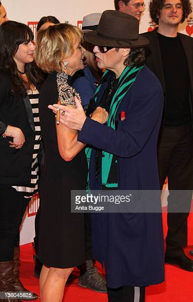 Uschi Glas and Udo Lindenberg arrive for the 'Ein Herz fuer Kinder' Charity Gala on December 17 2011 in Berlin Germany