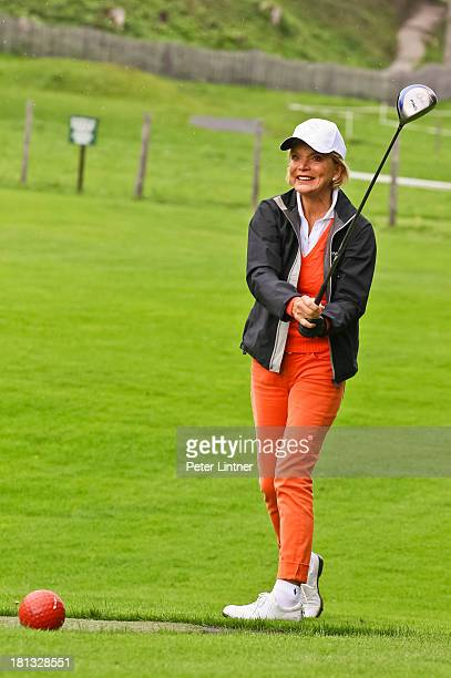 Uschi Glas of Germany plays a shot during the Toni Sailer Golf Memorial on September 20 2013 in Kitzbuehel Austria