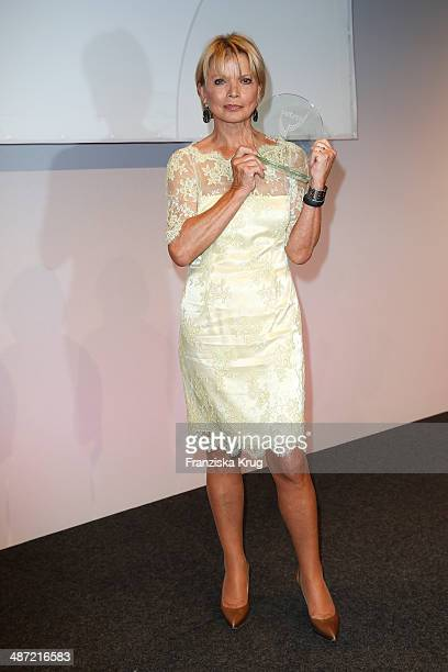 Uschi Glas poses with her award during the 9th Victress Awards Gala at andel's Hotel Berlin on April 28 2014 in Berlin Germany