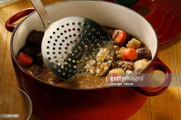 Use a ladle to skim the fat before you serve your beef stew