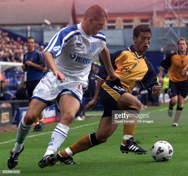 Burys Bhiachung Bhutia in action against Tranmeres Clint Hill during their Nationwide League Second Division match held at Prenton Park