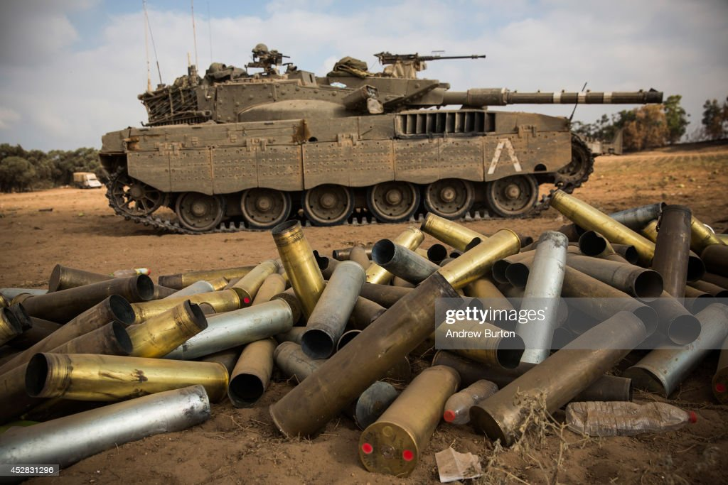 Used artillery shells litter the ground on the morning of July 28, 2014 near Kafar Azza, Israel. As Israel's operation 'Protective Edge' in Gaza continues, the international community struggles to find a truce agreement.