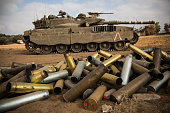Used artillery shells litter the ground on the morning of July 28 2014 near Kafar Azza Israel As Israel's operation 'Protective Edge' in Gaza...