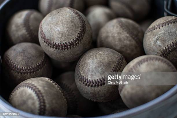 Used baseballs are seen in the dugout during a practice game between the Shonan Boys and the Yokohama Minami on July 30 2014 in Yokosuka Japan The...