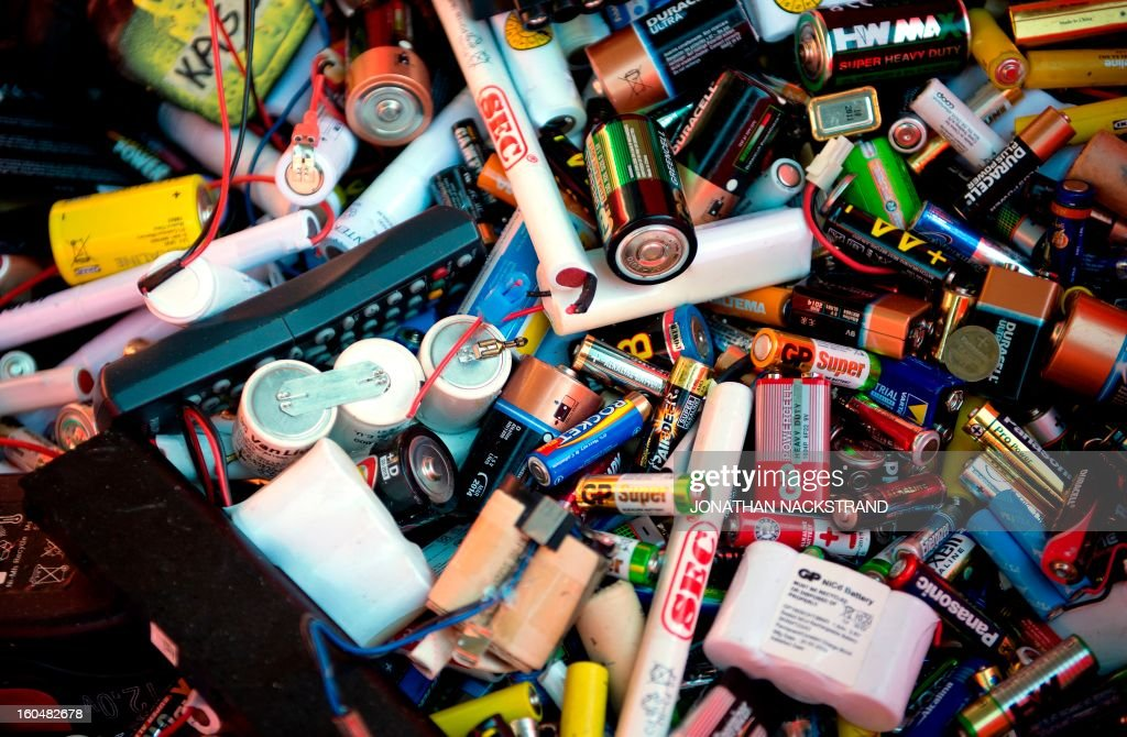 Used batteries are pictured in a container at the Ostberga recycling center, south of Stockholm on February 1, 2013.