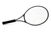 Seasoned black graphite tennis racket isolated on white background.