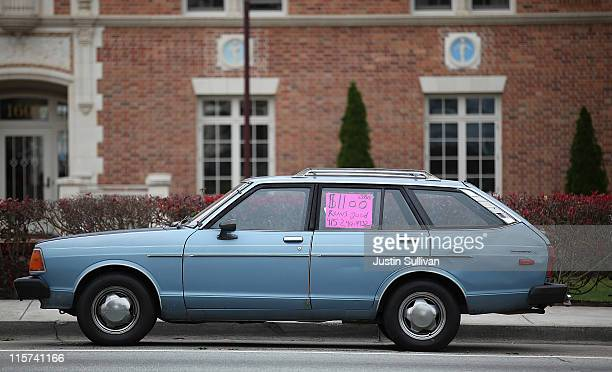 A used car with a for sale sign in its window sits on 19th Avenue on June 9 2011 in San Francisco California As the economy continues to falter and...