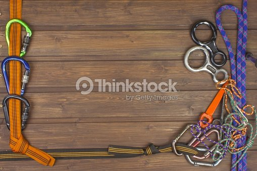 Used Climbing Gear On Wooden Background Advertising Boards Of Trade