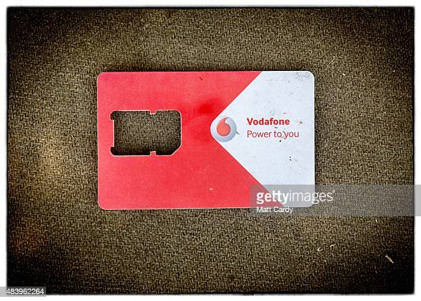 A used Greek mobile phone SIM card holder is seen after it was discarded beside railway tracks that run from Serbia into Hungary and is used as a...