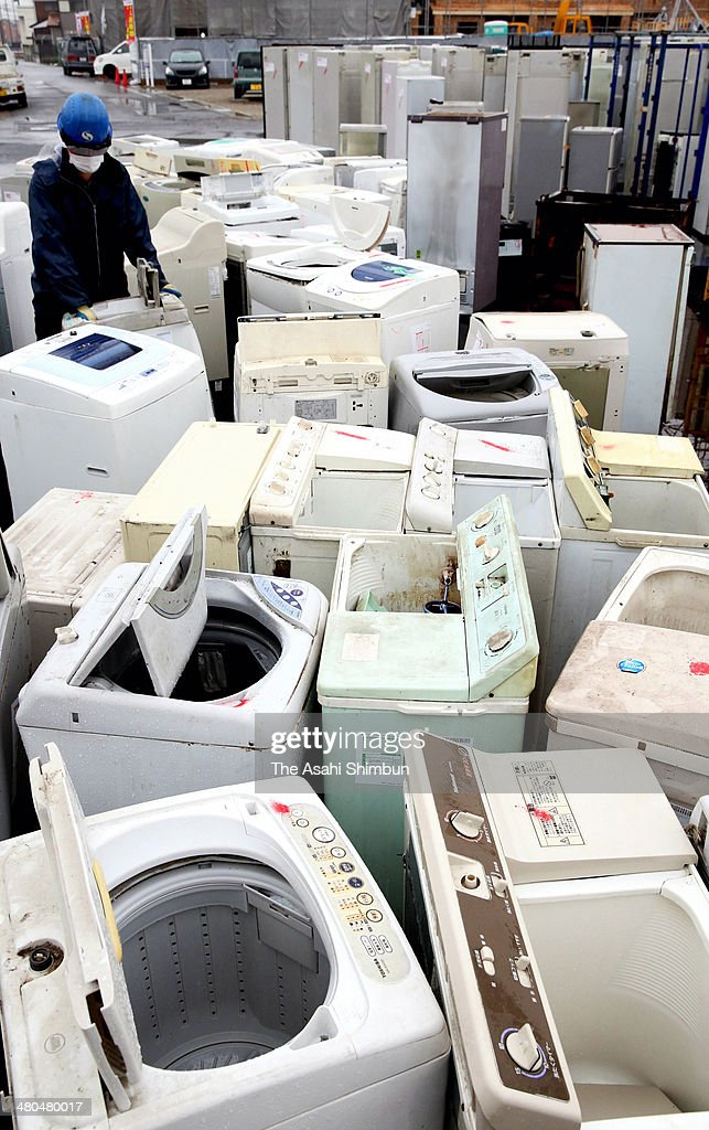 Used home electronics goods such as fridges, washing machines and air conditioners are arranged as they are being recycled after Japanese consumers rushed to replace them before the eight percent consumption tax applied on March 20, 2014 in Ichinomiya, Aichi, Japan. Japan raises consumption tax from 5 to 8 percent on April 1, and possibly to 10 percent in October 2015, despite market concerns about a slowing of the economic recovery.