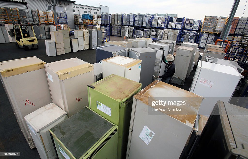Used home electronics goods such as fridges, washing machines and air conditioners are arranged as they are being recycled after Japanese consumers rushed to replace them before the eight percent consumption tax applied at a recycling company storage on March 25, 2014 in Kitakyushu, Fukuoka, Japan. Japan raises consumption tax from 5 to 8 percent on April 1, and possibly to 10 percent in October 2015, despite market concerns about a slowing of the economic recovery.