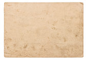 Used paper sheet isolated on white background. Vintage torn cardboard