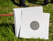 Used paper targets, with some bullet holes.