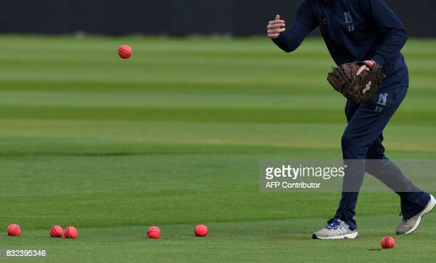 TOPSHOT Used pink cricket balls are pictured on the pitch during a training session on the eve of the first day of the first cricket Test Match...