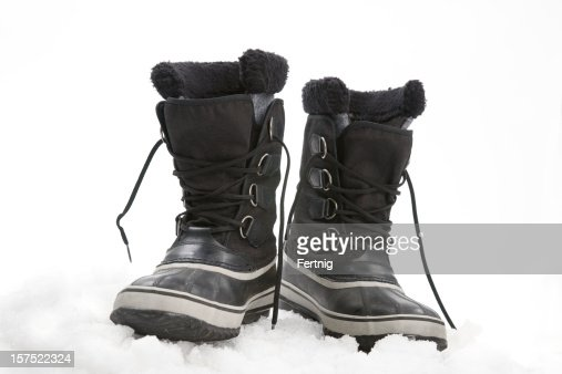 Used snow boots on ice, in studio.