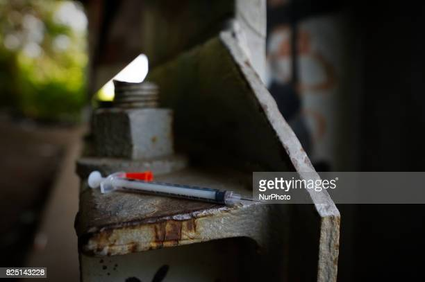 Used syringe found between piles of trash at the heroin camp located under the North Second Street overpass in the Kensington Section of Philadelphia...