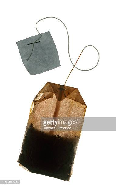 Used teabag on white background