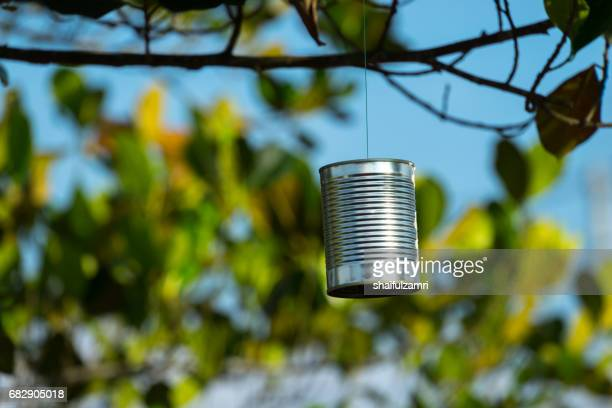 Used tin can hang on the tree to scare birds