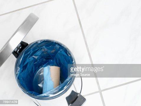 Used toilet roll in a bin