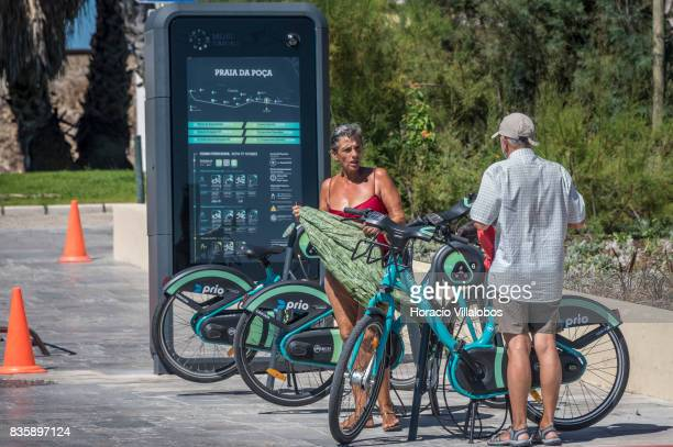 Users seen by BiCas point of collection of bicycles in Praia da Poca on August 18 2017 in Estoril Portugal Record year for tourism 2016 figures for...