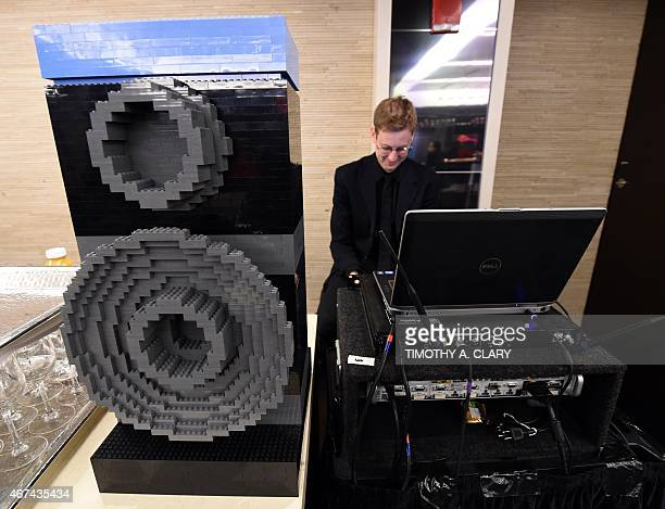 A DJ uses a Lego speaker as kids try out a fullsize replica of its new room theme during a media event in New York March 24 2015 to promote the...