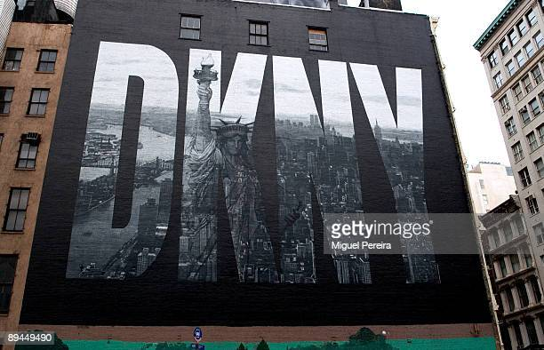 DKNY uses as advertising the image of Manhattan painted on the façade a Houston Street building in Manhattan New York City