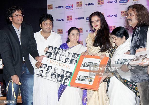 Usha Mangeshkar Rekha Lata Mangeshkar and Hariharan during the music launch of album 'Sarhadein' by Sa Re Ga Ma and Radio City at Taj Lands End Mumbai