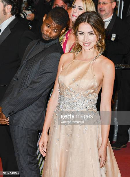 Usher and Ana De Armas attend the screening of 'Hands Of Stone' at the annual 69th Cannes Film Festival at Palais des Festivals on May 16 2016 in...