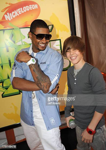 Usher and Justin Bieber arrive at Nickelodeon's 2009 Kids' Choice Awards at UCLA's Pauley Pavilion on March 28 2009 in Westwood California